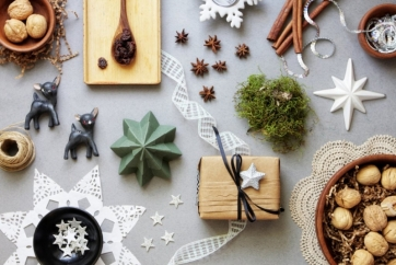 christmas-decor-craft-and-food-on-grey-paper-from-above-picture-id513569501 (1).jpg